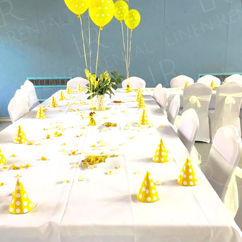 Birthday Party - White tablecloths and fitted chair covers complemented by bright yellow accessories.